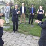 Ambassador Seiji Morimoto and minister Hideki Ishizuka show off how to do the san-san-nana