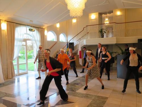 Alumni members performing a short Soran bushi for the ambassador and staff.